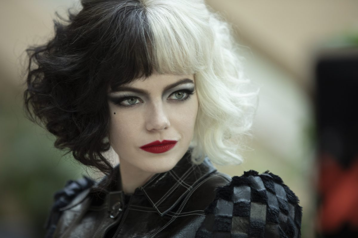 Emma Stone as Cruella in Disney's live-action CRUELLA. Photo by Laurie Sparham
